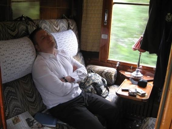 rail expert exhausted from his fun adventures on the train